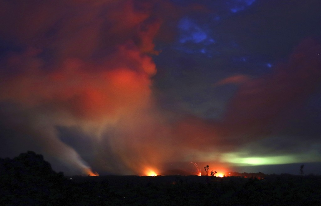ADVANCE FOR RELEASE FRIDAY, MAY 3, 2019 AT 12:01 A.M. EDT AND THEREAFTER. FILE - In this May 15, 2018 file photo, lava shoots into the night sky from ...