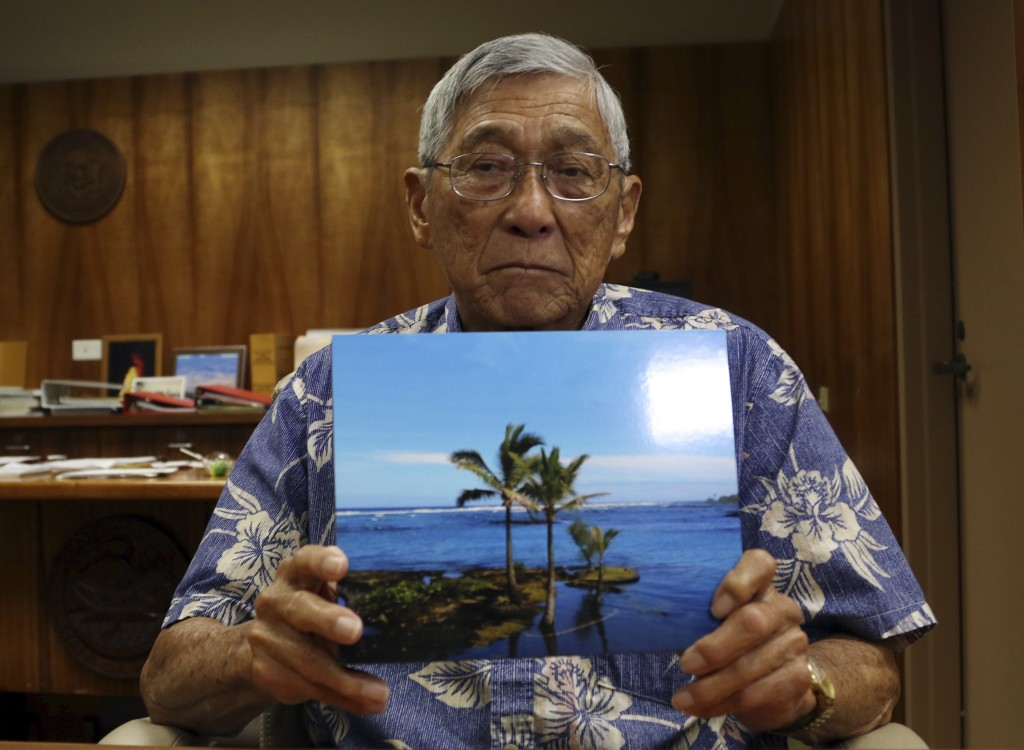 ADVANCE FOR RELEASE FRIDAY, MAY 3, 2019 AT 12:01 A.M. EDT AND THEREAFTER. In this Wednesday, April 24, 2019 photo, Big Island Mayor Harry Kim holds a ...