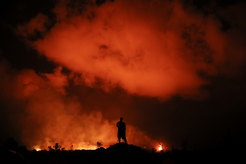 ADVANCE FOR RELEASE FRIDAY, MAY 3, 2019 AT 12:01 a.m. EDT AND THEREAFTER FILE - In this Friday, May 18, 2018 file photo, Peter Vance photographs lava ...