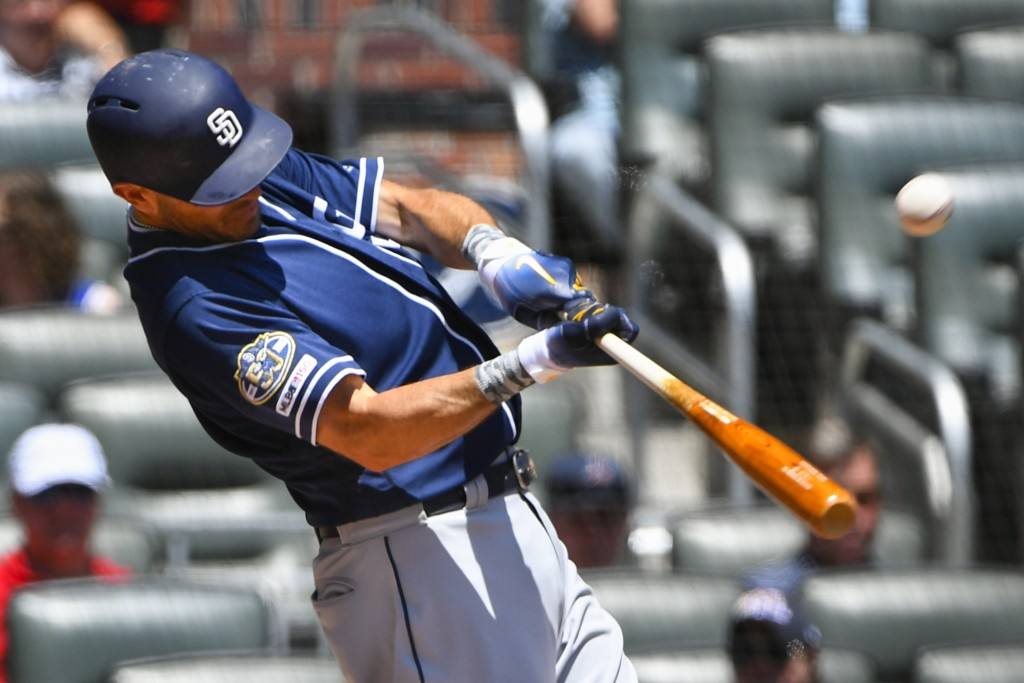 San Diego Padres' Ian Kinsler connects for a double to left field during the sixth inning of a baseball game against the Atlanta Braves, Thursday, May