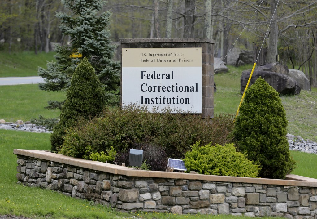 In this May 1, 2019 photo, a sign marks the entrance to the Federal Correctional Institution, Otisville in Mount Hope, N.Y. President Donald Trump's f...