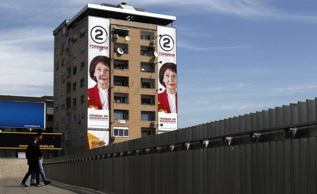 """Campaign posters of Gordana Siljanovska Davkova, a candidate for the opposition conservative VMRO-DPMNE party, that read: """"Justice for Macedonia"""" are"""