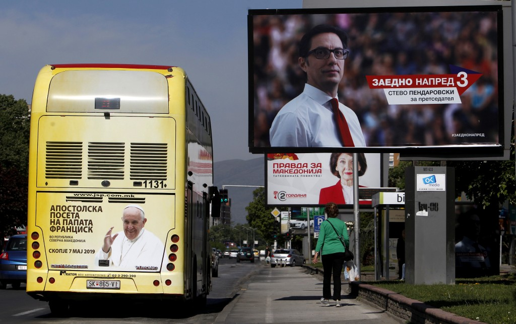 A bus with a poster announcing the upcoming visit ...