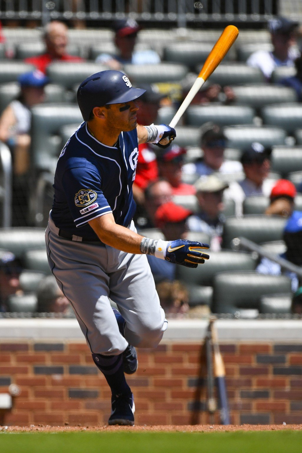 San Diego Padres' Ian Kinsler watches his one-run RBI line drive double to left field during the fifth inning of a baseball game against the Atlanta B