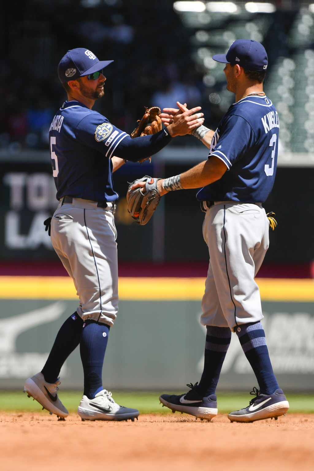 San Diego Padres' Greg Garcia and Ian Kinsler, right, congratulate each other after a baseball game against the Atlanta Braves, Thursday, May 2, 2019 ...