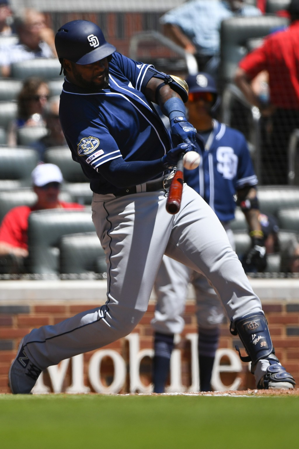 San Diego Padres' Franmil Reyes connects for fly ball to center field to single against the Atlanta Braves during the fifth inning of a baseball game ...