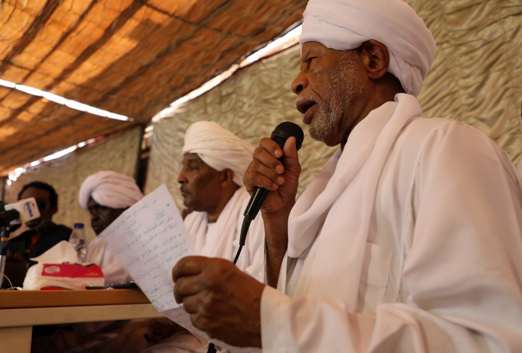FILE - In this April 28, 2019, file, photo, Ibrahim al-Senoussi, a former aide to ousted President Omar al-Bashir, right, speaks at a press conference