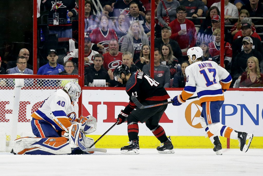 Carolina Hurricanes' Greg McKegg (42) scores against New York Islanders goalie Robin Lehner (40), of Sweden, during the second period of Game 4 of an ...