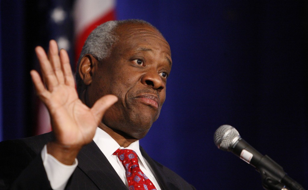 FILE - In this Nov. 15, 2007, file photo, Supreme Court Justice Clarence Thomas addresses the Federalist Society in Washington. Thomas is now the long...
