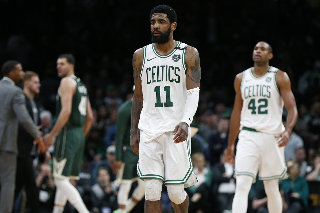 Boston Celtics' Kyrie Irving (11) and Al Horford (42) walks to the bench during a timeout in the second half of Game 3 of the team's second-round NBA ...