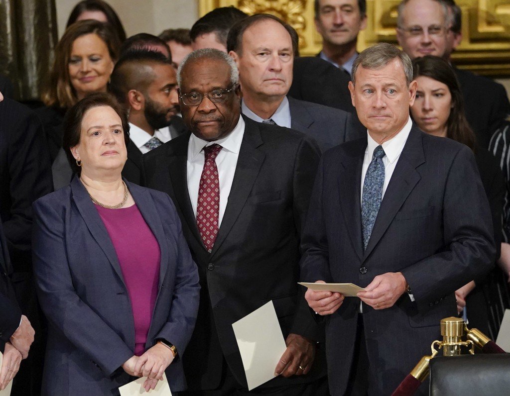 FILE - In this Dec. 3, 2018, file photo, from left, Supreme court Associate Justices Elena Kagan, Clarence Thomas, Samuel Alito and Chief Justice John...