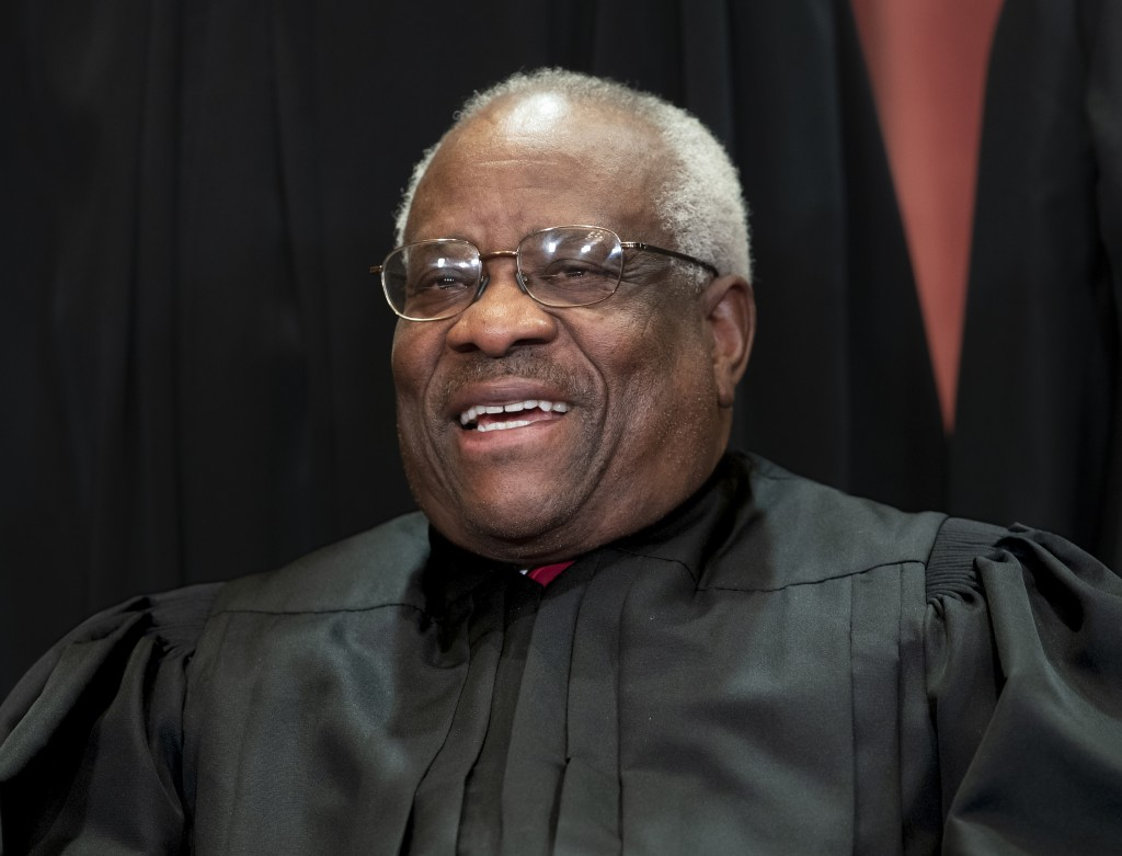 FIILE - In this Nov. 30, 2018, file photo, Supreme Court Associate Justice Clarence Thomas, appointed by President George H. W. Bush, sits with fellow...