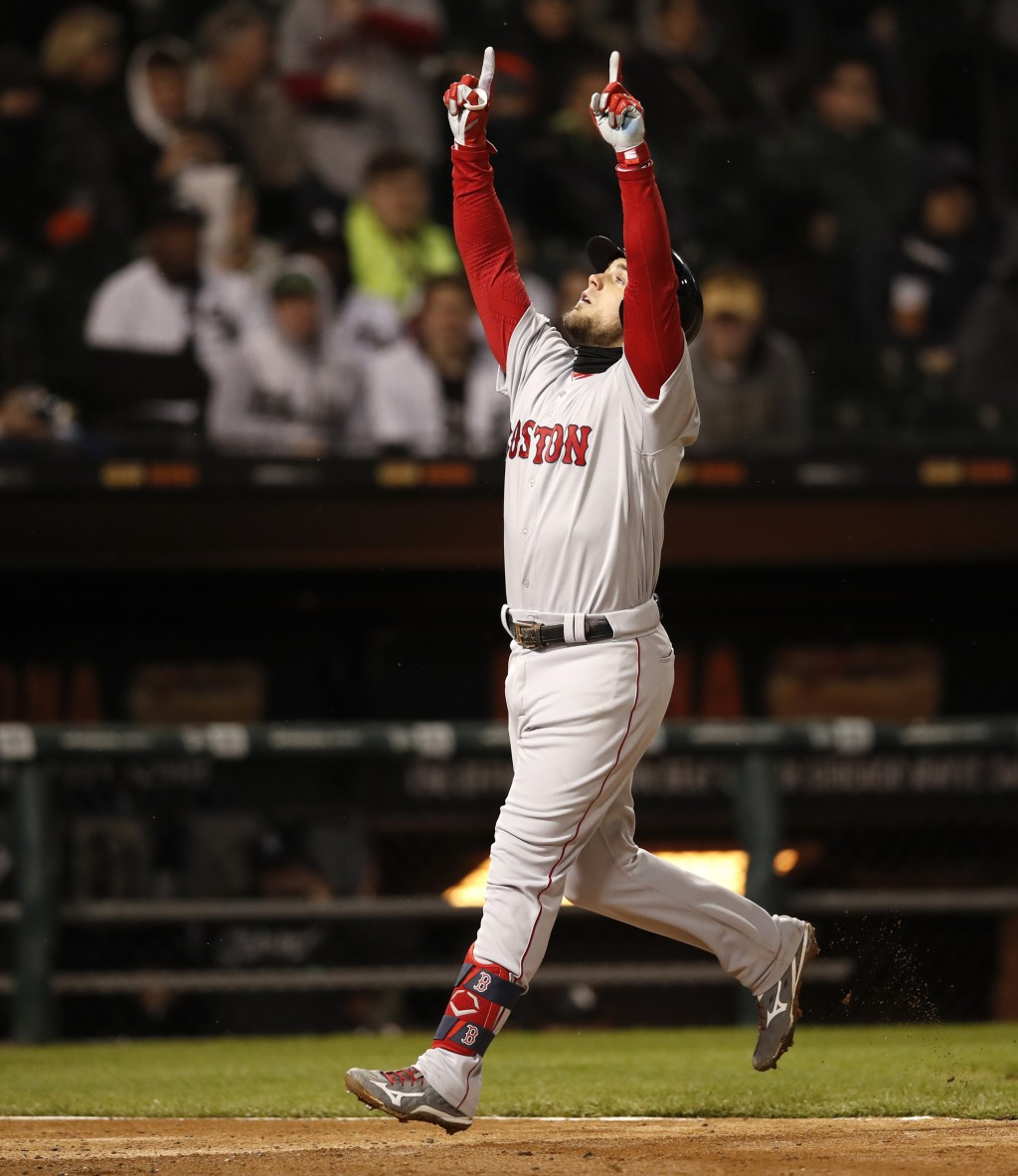 Boston Red Sox's Michael Chavis celebrates his two-run home run during the sixth inning of a baseball game against the Chicago White Sox in Chicago, F...