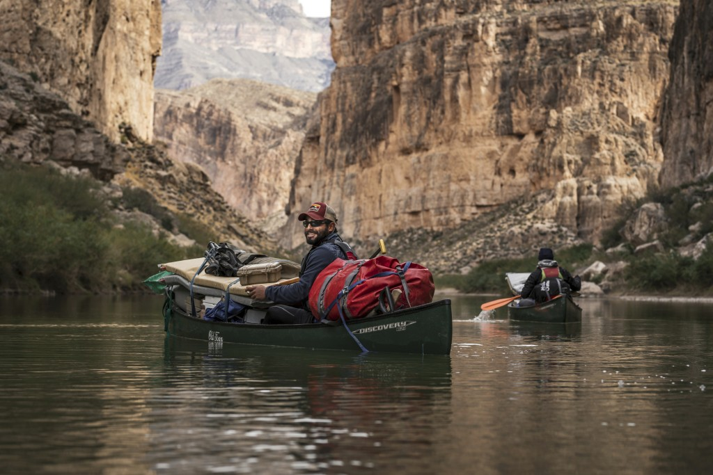 This December 2018 photo released by Fin and Fur Films shows guide Austin Alvarado paddling through Boquillas Canyon in Big Bend National Park, Texas,...