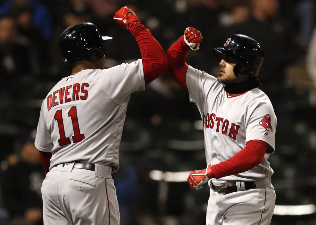 Boston Red Sox's Michael Chavis celebrates his two-run home run with teammate Rafael Devers (11) during the sixth inning of a baseball game against th...