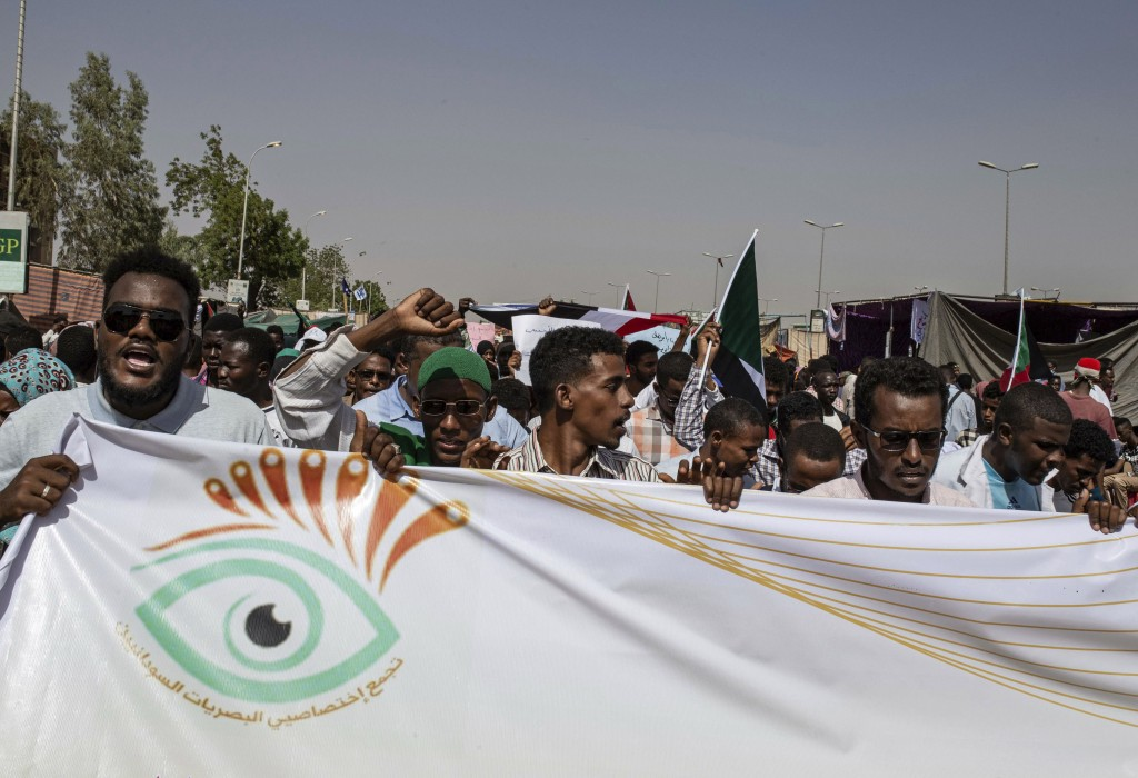 FILE - In this April 28, 2019, file photo, protesters chant against military rule and demand the prosecution of former officials, at the Armed Forces