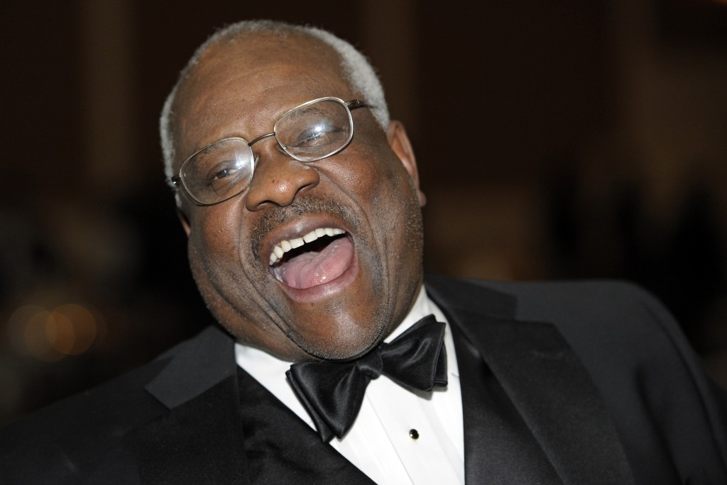 FILE - In this Nov. 10, 2011, file photo Supreme Court Justice Clarence Thomas laughs while talking with other guests at The Federalist Society's 2011...