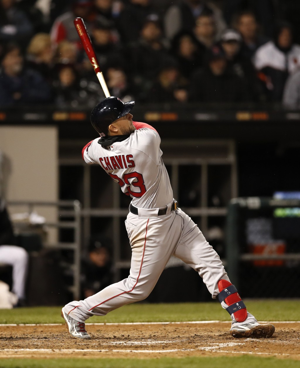 Boston Red Sox's Michael Chavis watches his two-run home run during the sixth inning of a baseball game against the Chicago White Sox in Chicago, Frid...