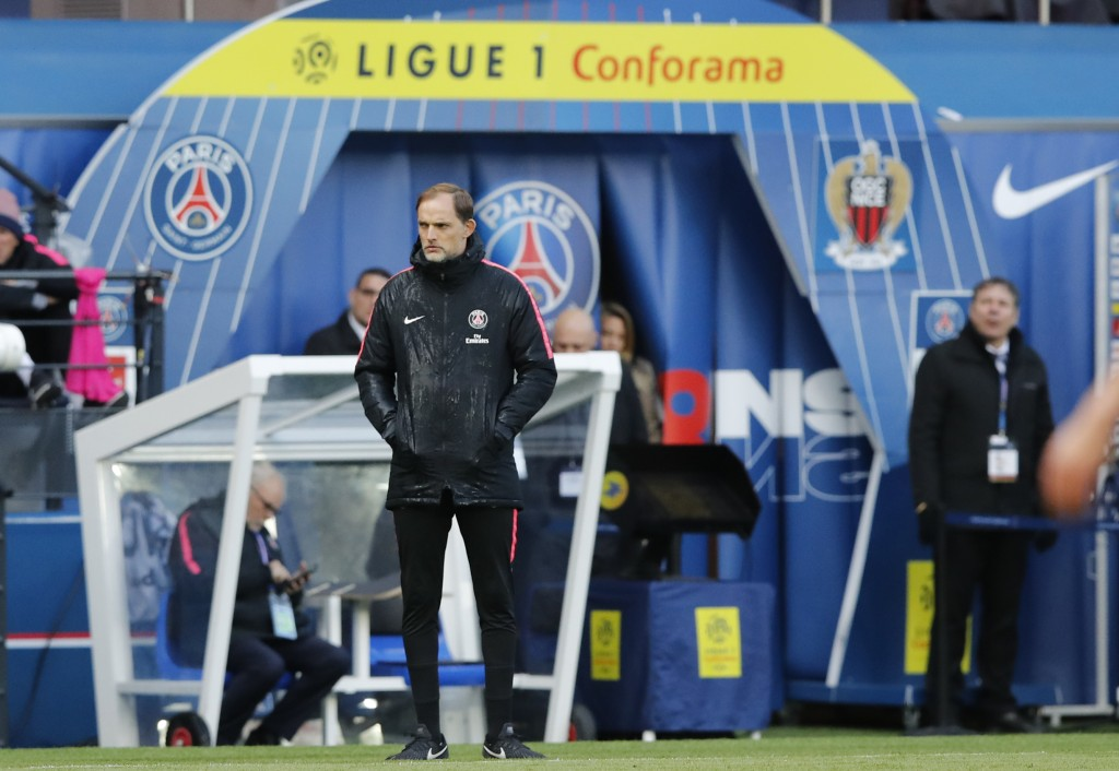 PSG coach Thomas Tuchel watches his team during the French League One soccer match between Paris Saint-Germain and Nice at the Parc des Princes stadiu