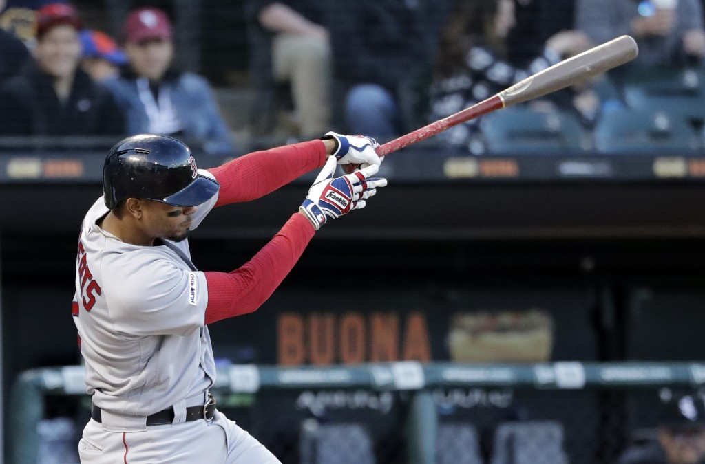 Boston Red Sox's Xander Bogaerts hits a two-run home run against the Chicago White Sox during the third inning of a baseball game in Chicago, Saturday