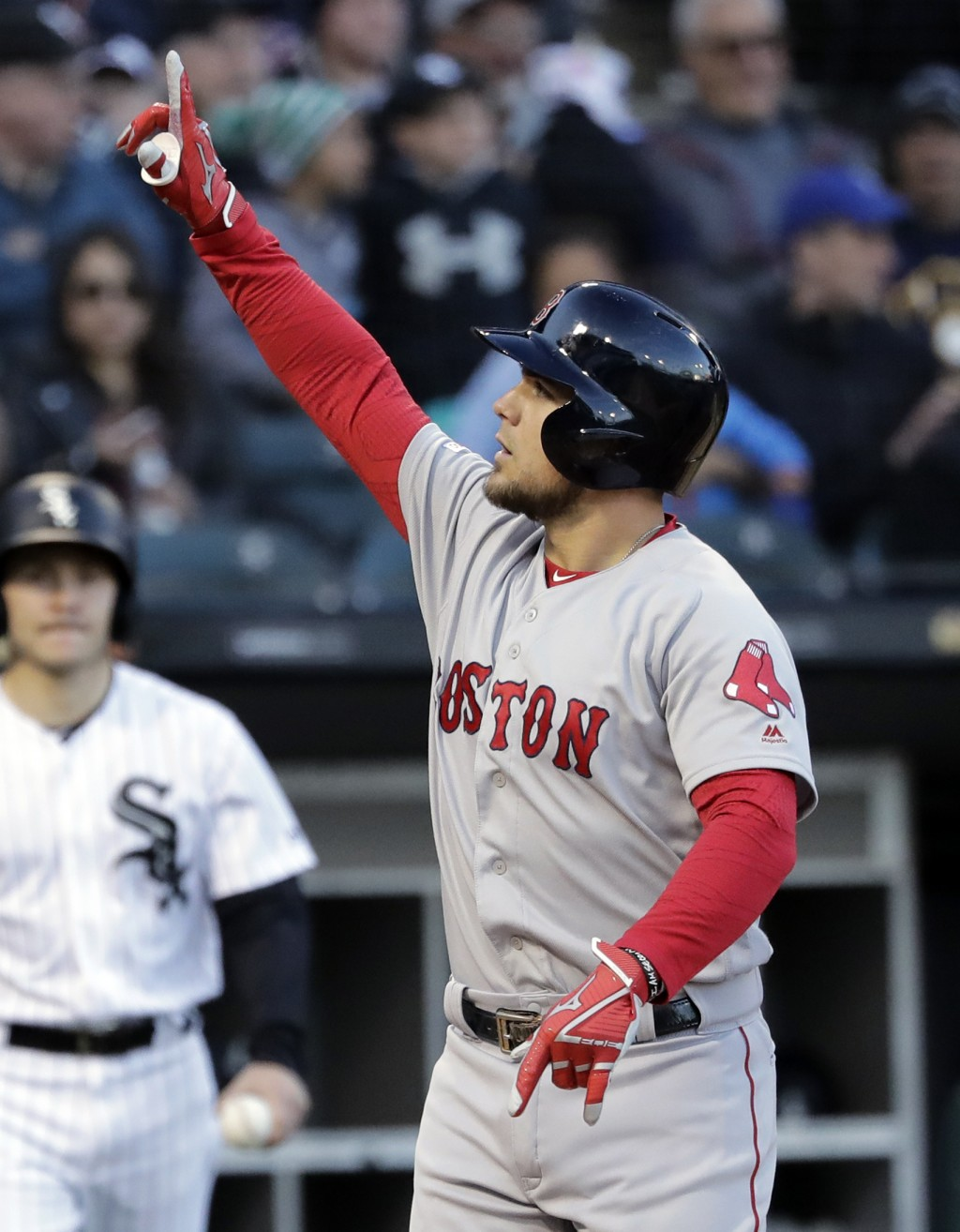 Boston Red Sox's Michael Chavis celebrates after hitting a solo home run against the Chicago White Sox during the third inning of a baseball game in C...