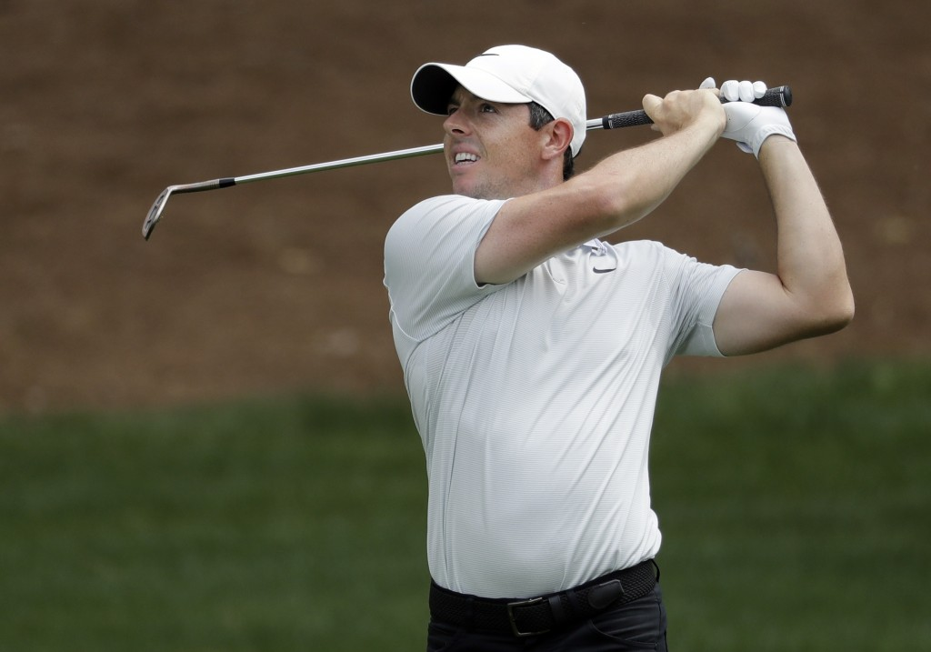 Rory McIlroy, of Northern Ireland, watches his approach shot on the second hole during the third round of the Wells Fargo Championship golf tournament...