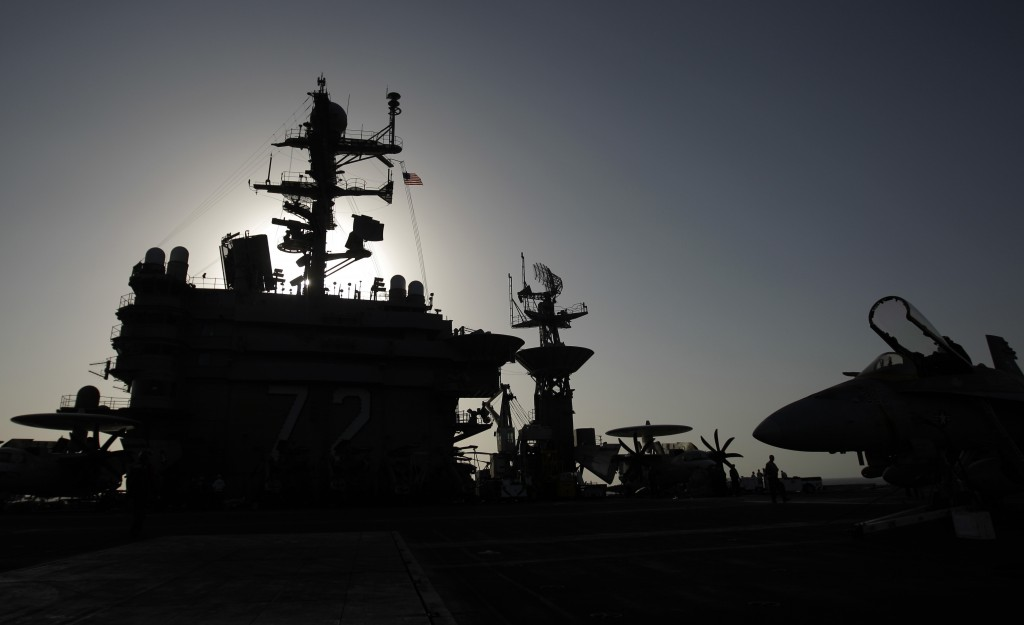 FILE - This Feb. 14, 2012, file photo shows the bridge of the Nimitz-class aircraft carrier USS Abraham Lincoln (CVN 72). The U.S. is dispatching the ...