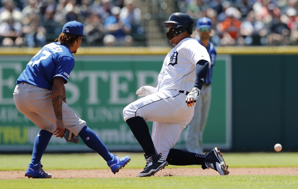 Detroit Tigers' Miguel Cabrera beats the throw to Kansas City Royals second baseman Adalberto Mondesi for a double during the first inning of a baseba