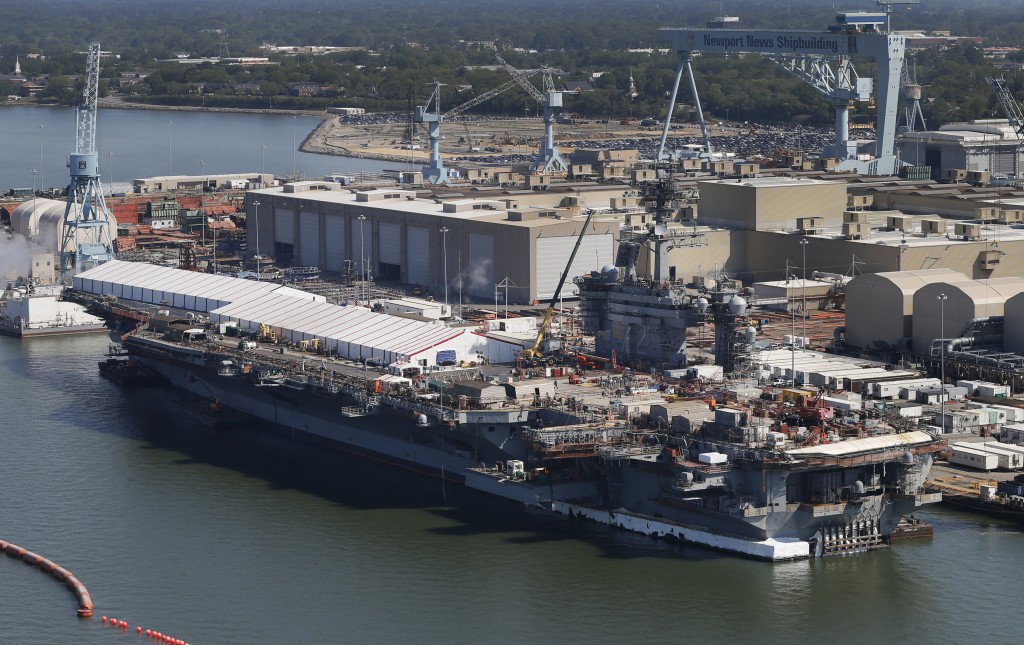 FILE - This April 27, 2016, file photo, shows the nuclear powered aircraft carrier USS Abraham Lincoln at Newport News Shipbuilding in Newport News, V...