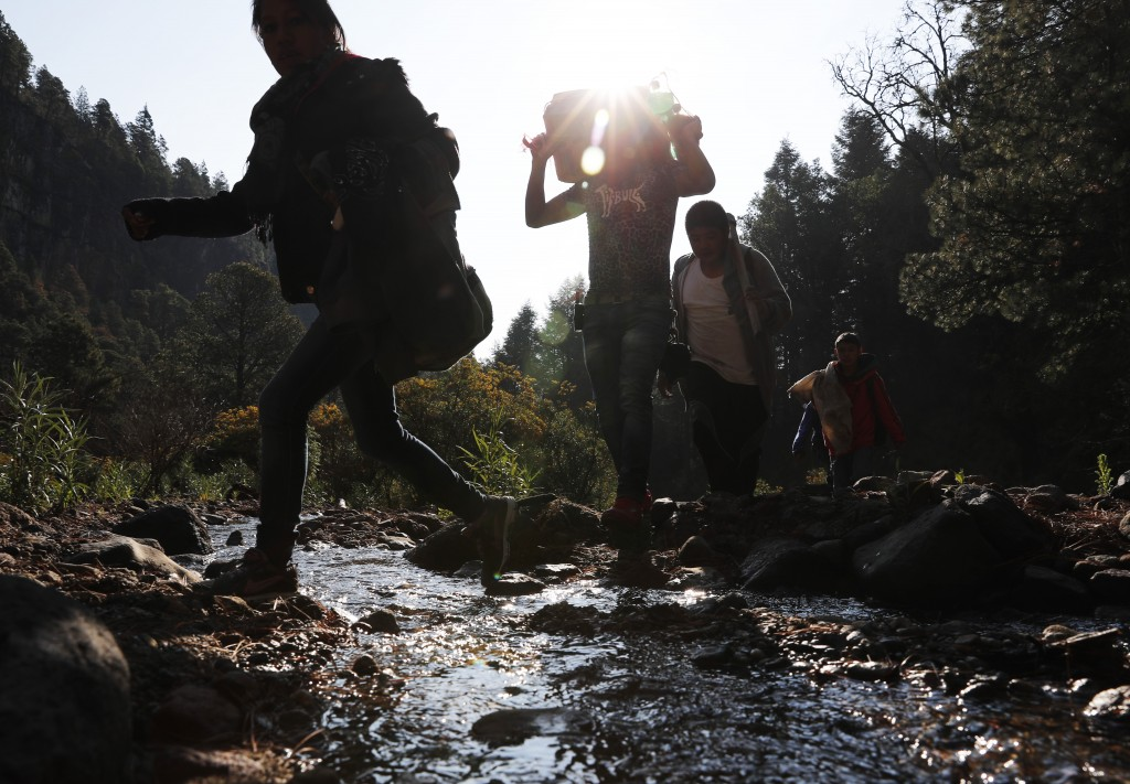 In this Friday, May 3, 2019 photo, pilgrims hike to an altar on the flanks of the Iztaccíhuatl volcano or The Sleeping Woman (the volcano resembles a ...