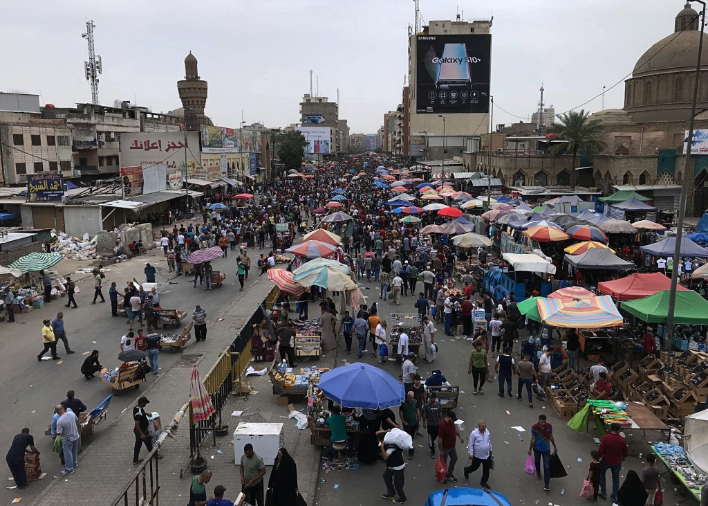 In this Friday, May 3, 2019 photo, Iraqis shop for food in a preparation for the Muslim fasting month of Ramadan at the Shorjah market in central Bagh