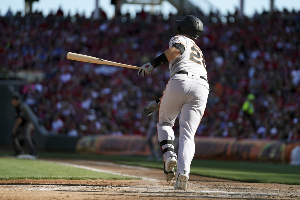 San Francisco Giants' Buster Posey watches his three-run home run in the sixth inning of a baseball game against the Cincinnati Reds, Sunday, May 5, 2