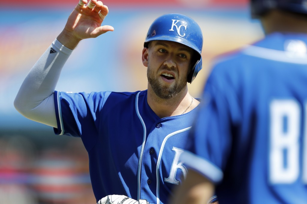 Kansas City Royals' Hunter Dozier is greeted after solo home run during the eighth inning of a baseball game against the Detroit Tigers, Sunday, May 5...