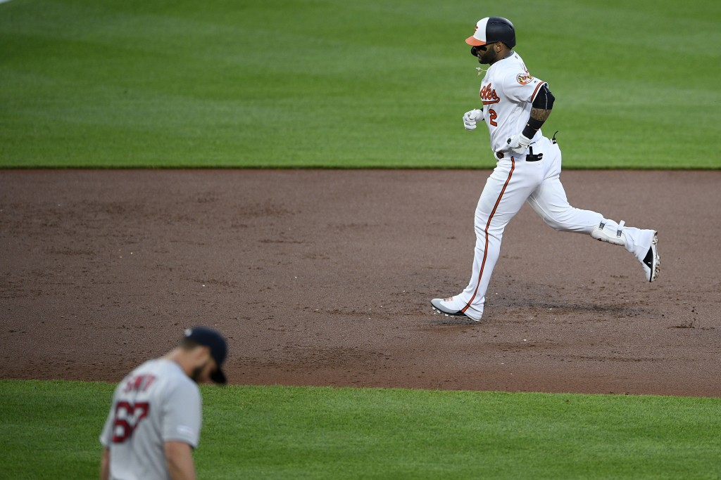 Baltimore Orioles' Jonathan Villar (2) rounds the bases after his grand slam off Boston Red Sox starting pitcher Josh Smith (67) during the second inn...
