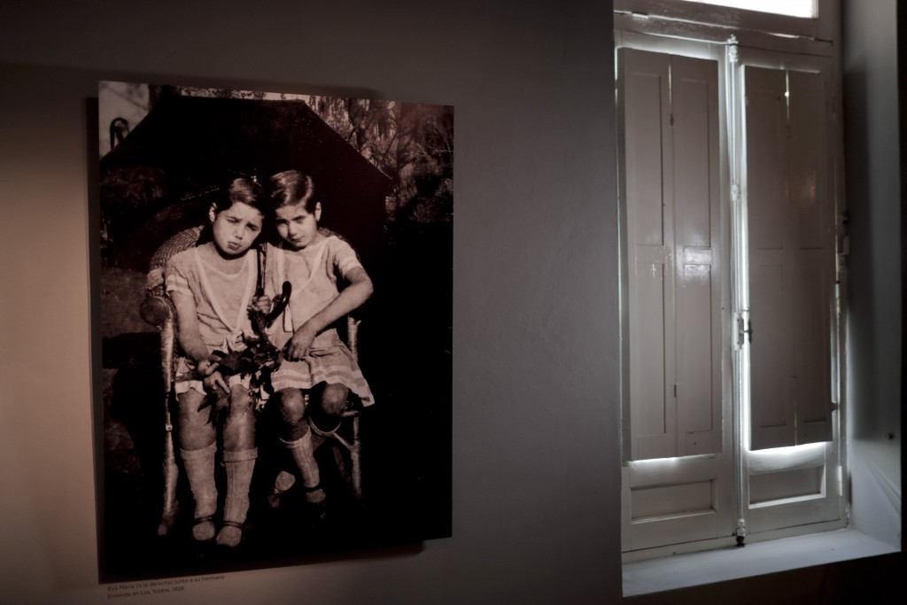 A 1926 photograph of Eva Perón, right, with her sister Erminda hangs in the home she was born and raised in until her 11th birthday, in Los Toldos, Ar...