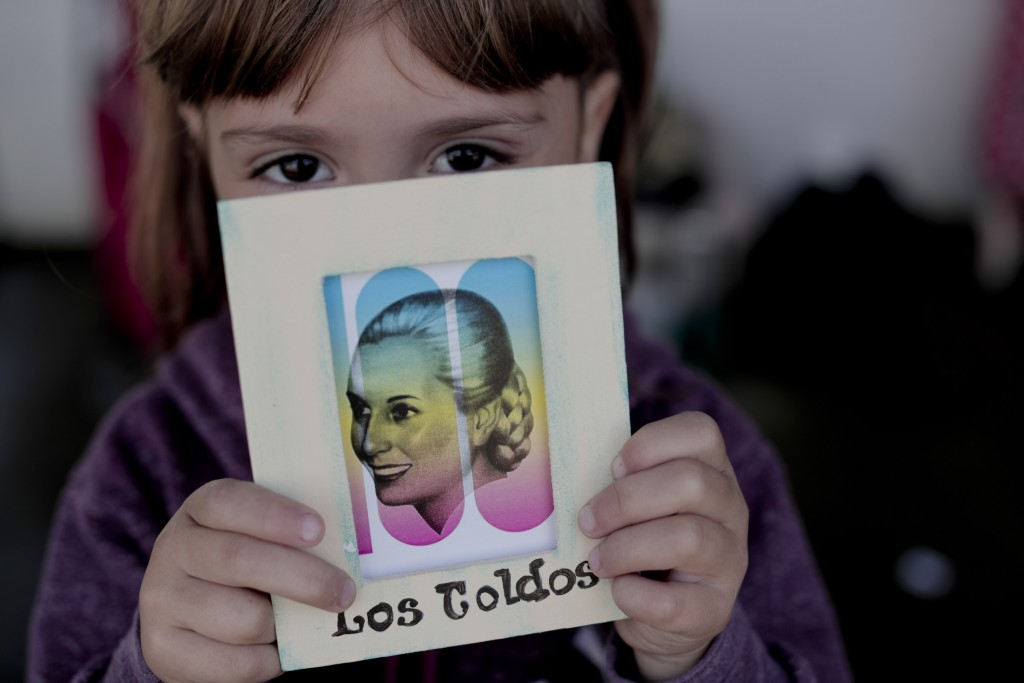 Lariza Monia holds a drawing of Eva Peron at a fair in Los Toldos, Argentina, Monday, May 6, 2019. One day ahead of the 100th anniversary of Evita's b