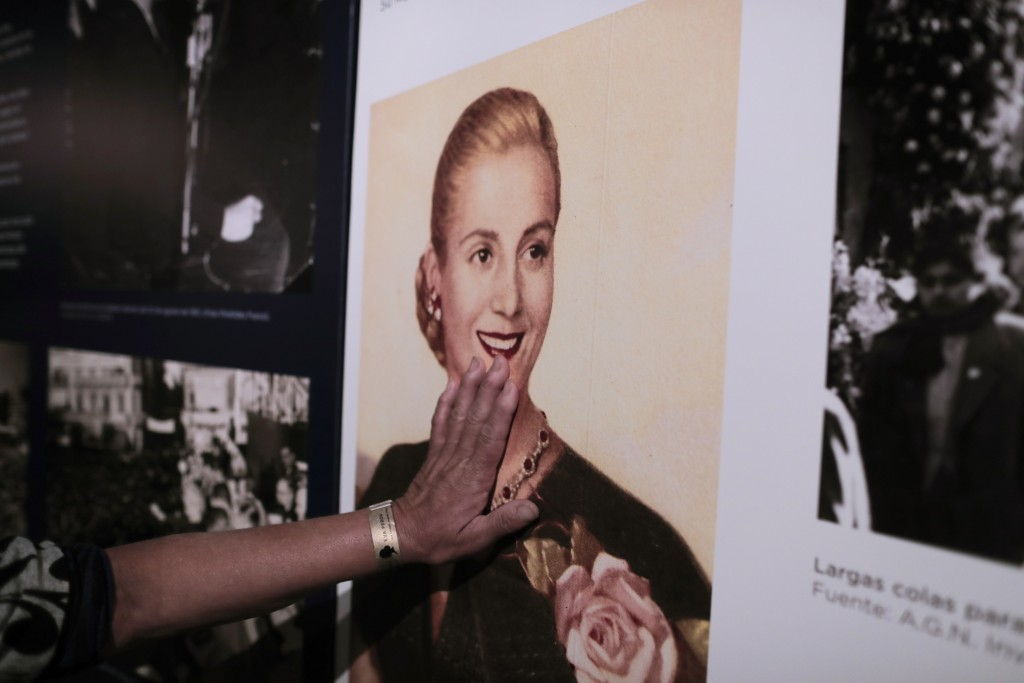 """A woman touches a picture of Eva Peron on display at the home-turned-museum """"Casa Museo Eva Perón"""" in Los Toldos, Argentina, Monday, May 6, 2019. One"""