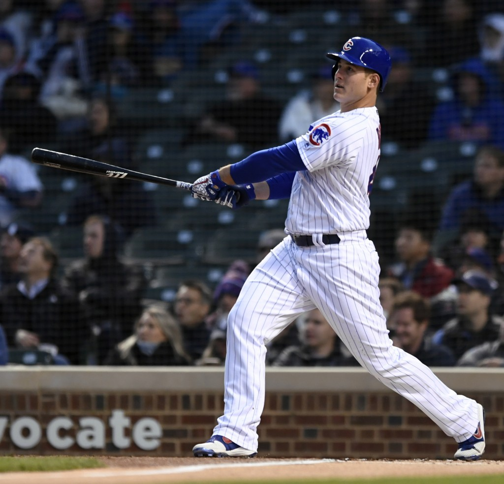 Chicago Cubs' Anthony Rizzo watches his two-run home run during the first inning of a baseball game against the Miami Marlins, Monday, May 6, 2019, in...
