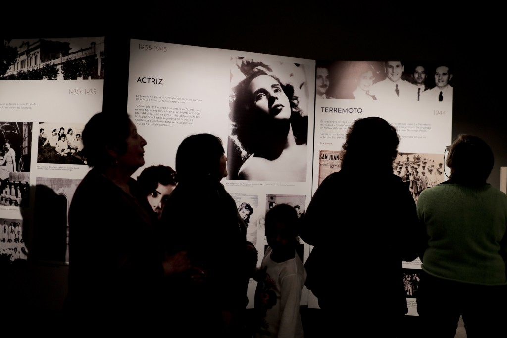 """Visitors look at pictures of Eva Perón on display inside the home-turned-museum """"Casa Museo Eva Perón"""" in Los Toldos, Argentina, Monday, May 6, 2019."""