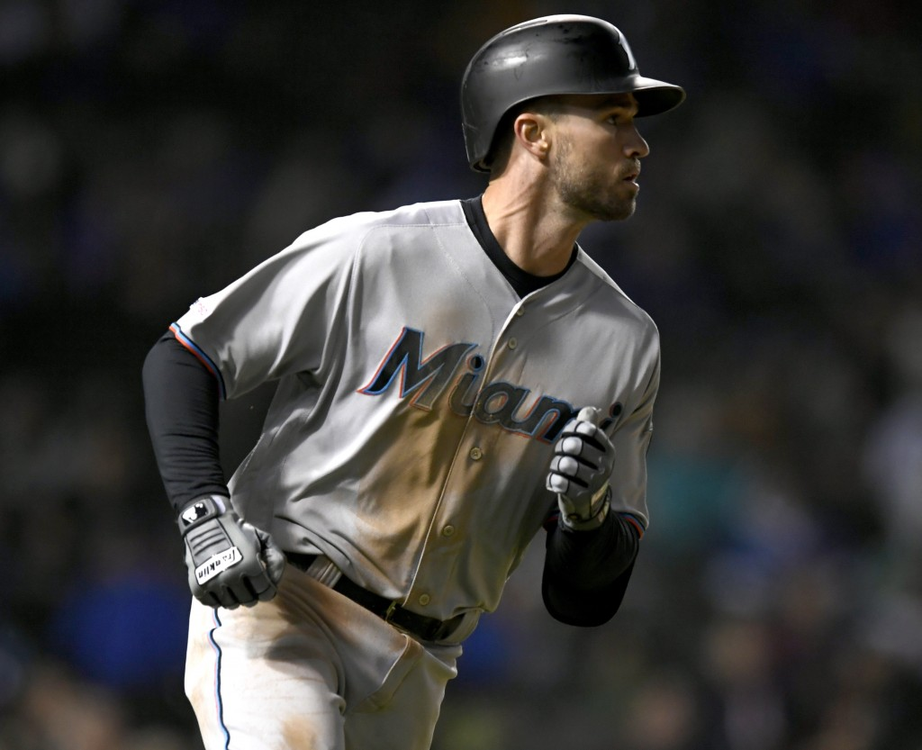 Miami Marlins' Jon Berti watches his solo home run during the sixth inning of a baseball game against the Chicago Cubs, Monday, May 6, 2019, in Chicag...
