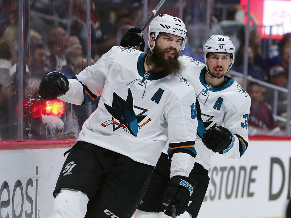 San Jose Sharks defenseman Brent Burns, front, reacts after scoring a goal as center Logan Couture follows in the second period of Game 6 of an NHL ho