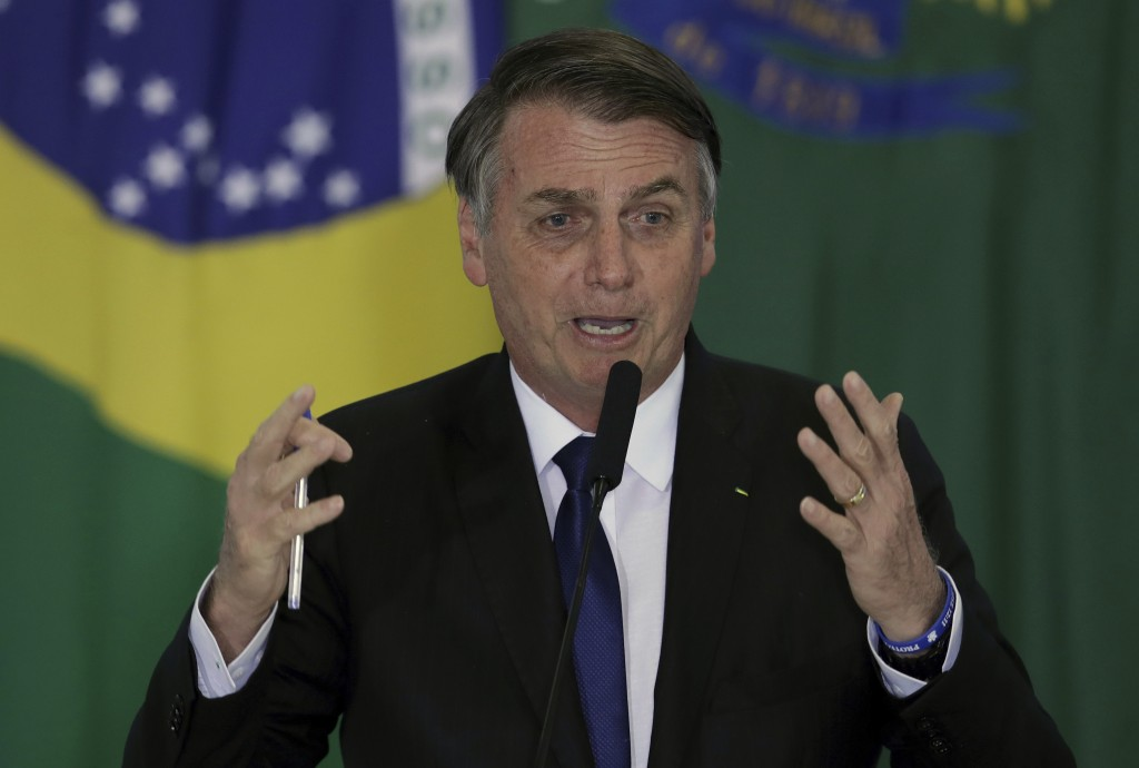 Brazil's President Jair Bolsonaro speaks during a ceremony where he signed a second decree that eases gun restrictions, during the signing ceremony at