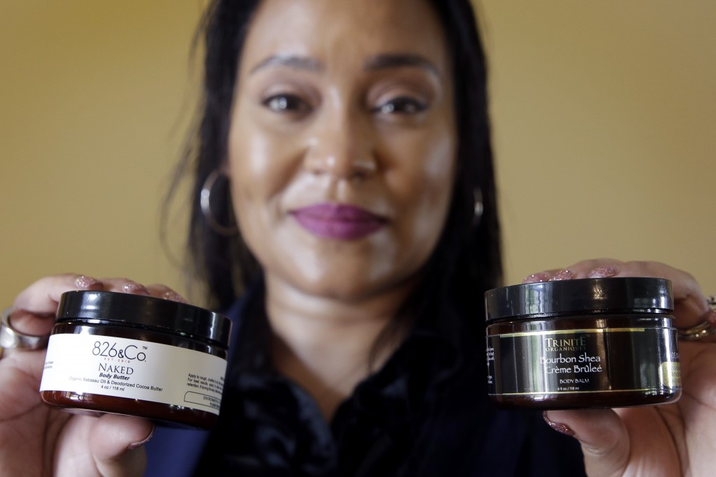 In this Monday, May 6, 2019, photo Jamie Masters shows her beauty products with the new labeling, at left, and old labeling, at right, in her home in ...