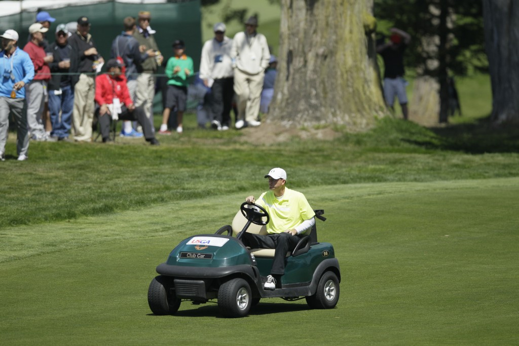 FILE - In this June 15, 2012, file photo, Casey Martin drives to the fifth green during the second round of the U.S. Open golf tournament at The Olymp