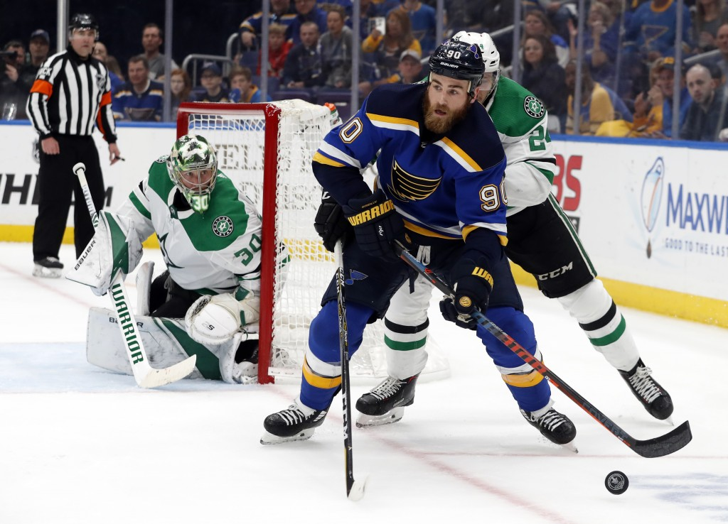 Dallas Stars goaltender Ben Bishop (30) watches as St. Louis Blues center Ryan O'Reilly (90) attempts to set up a shot during the second period in Gam