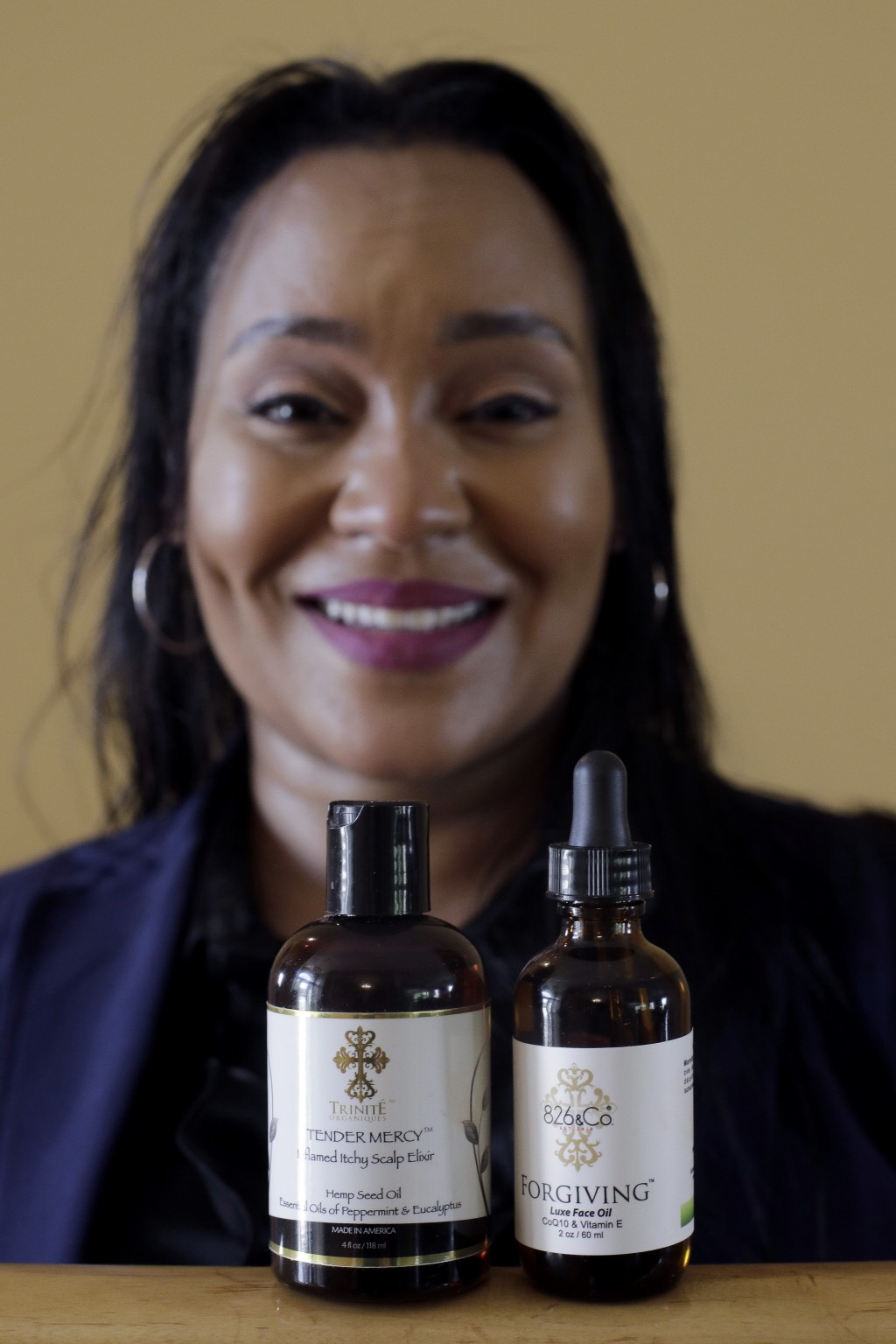 In this Monday, May 6, 2019, photo Jamie Masters shows her beauty products with the new labeling, at right, and old labeling, at left, in her home in