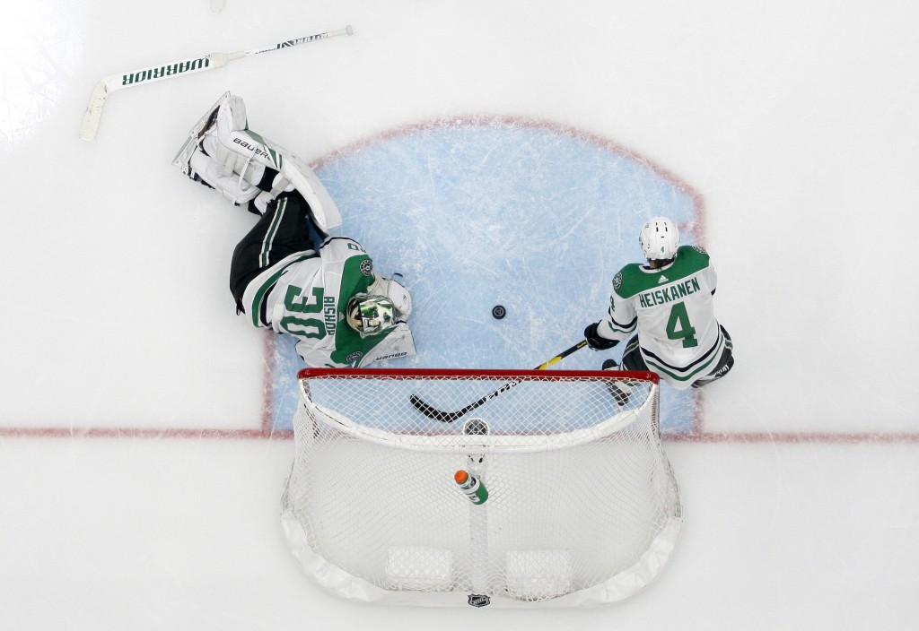 Dallas Stars' Ben Bishop (30) and Miro Heiskanen (4) lie by the net after giving up a score to St. Louis Blues' Pat Maroon during the second overtime
