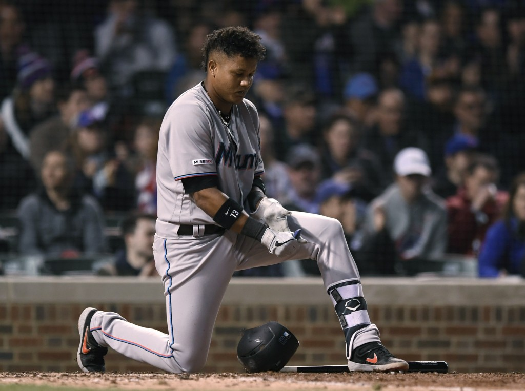 Miami Marlins' Starlin Castro reacts after striking out during the sixth inning of the team's baseball game against the Chicago Cubs on Wednesday, May...