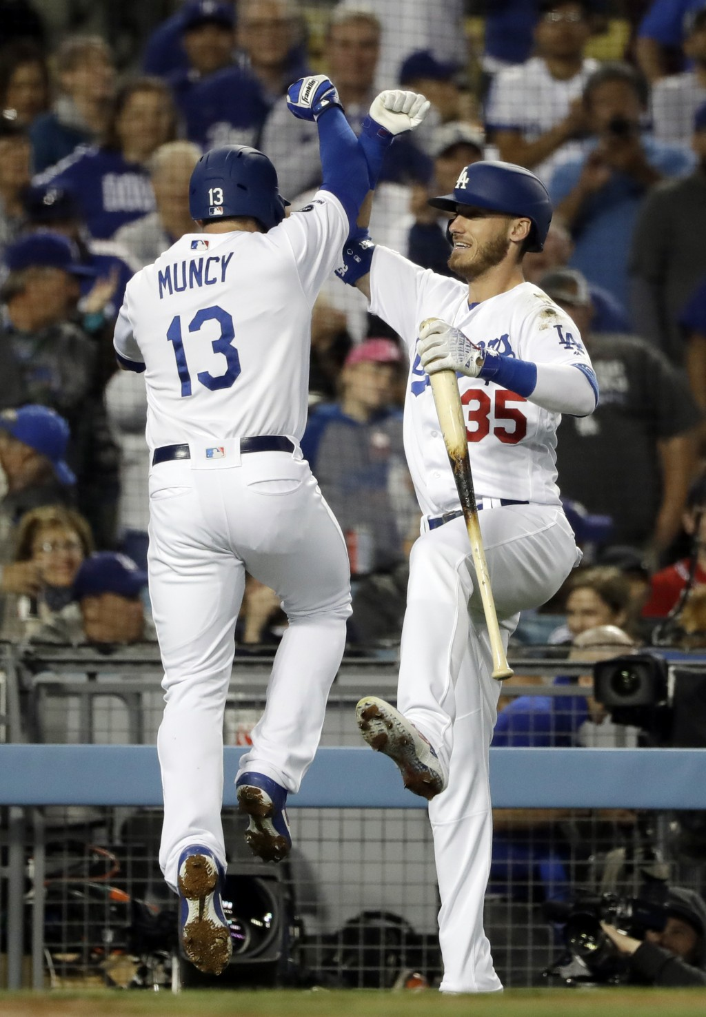 Los Angeles Dodgers' Max Muncy (13) celebrates his solo home run with Cody Bellinger during the third inning of the team's baseball game against the A...