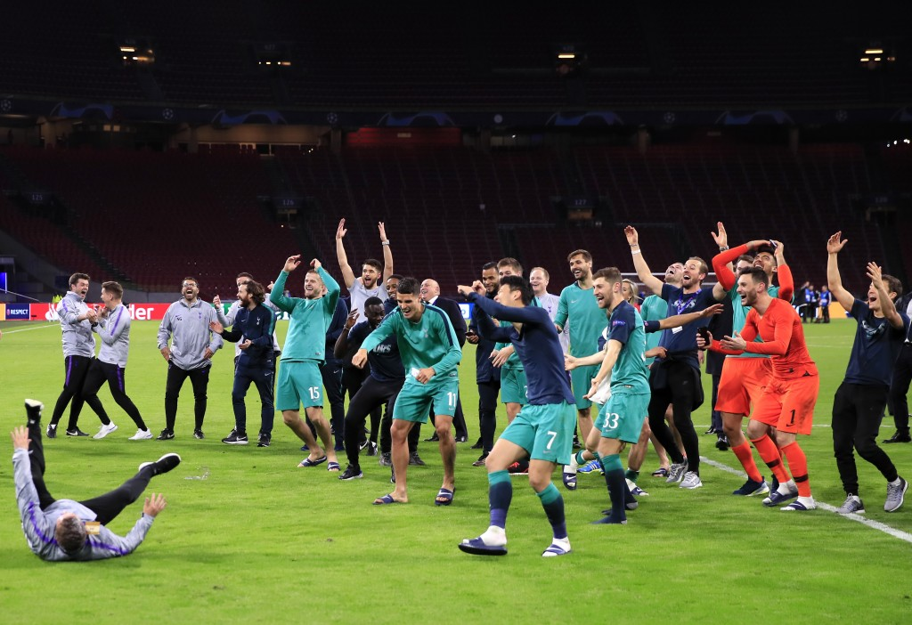 Tottenham players and staff celebrate in front of the fans at the end of the Champions League semifinal second leg soccer match between Ajax and Totte